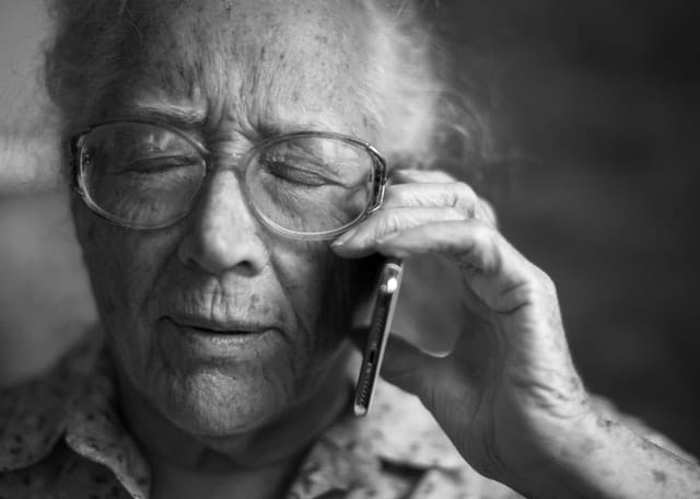 Person with hearing loss trying to talk on a cellphone